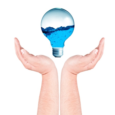 Light bulb with water inside on hands photo