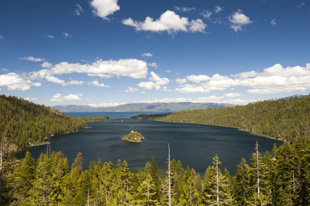 Emerald Bay with beautiful cloudy sky and green tree in the foreground, South Lake Tahoe, California, USA photo