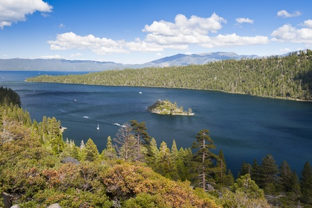 south lake tahoe: Emerald Bay with beautiful cloudy sky and green tree in the foreground, South Lake Tahoe, California, USA