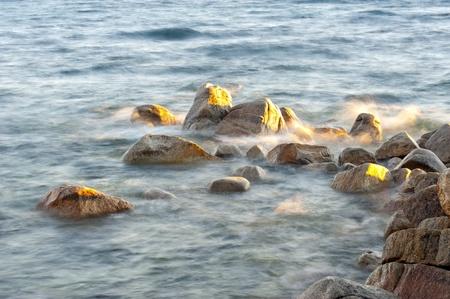 south lake tahoe: Water splash on rock with mountain in the background at Lake Tahoe, California, USA