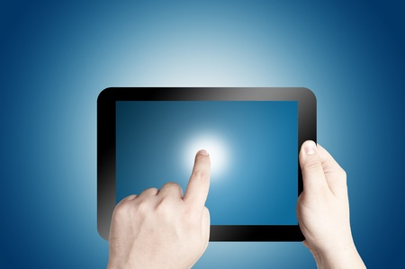 Hand holding and pointing on touch screen digital tablet Stock Photo - 12940064