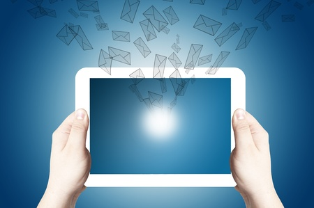 Hands holding and point on digital tablet with 3D mail icon flying out of touch screen Stock Photo - 12940072