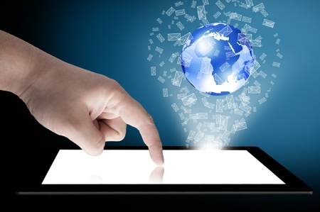 Businessman touch tablet PC screen with blue internet globe coming out from the screen and mail icon  Concept for internet and connectivity Stock Photo - 13000590