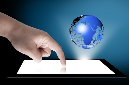 internet globe: Businessman touch tablet PC screen with blue internet globe coming out from the screen  Concept for internet and connectivity