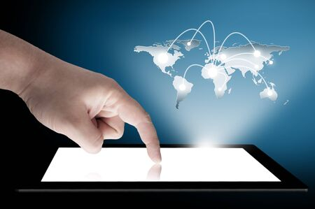 man s: Man s finger pointing on the touch screen tablet PC with 3D world map raising from the screen  Concept for connectivity Stock Photo