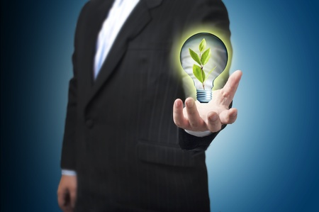 go inside: Business man with green plant inside light bulb  Concept for idea and GO green Stock Photo