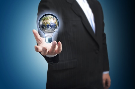 Business man with the digital globe ball inside light bulb floating on his hand  Concept for connectivity, communication within grasp Stock Photo - 13000557