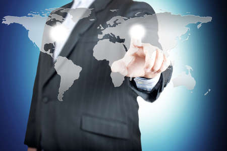 Business man pointing on the touch screen with world map  Concept for connectivity Stock Photo - 13000546