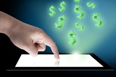 Dollar sign floating out from tablet PC  Concept for business growth photo