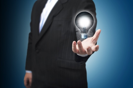 Business man with the light bulb floating on his hand  Concept for new Idea photo