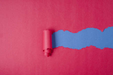 Red Tear Paper on blue background photo