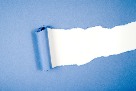 Blue Tear Paper on white background photo