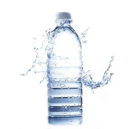 bottle of water and water splash isolated on white photo