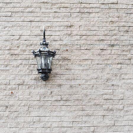 Lamp on old brick wall photo