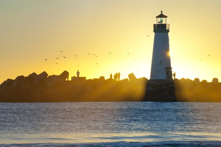 Windsurf and Silhouette Lighthouse Stock Photo - 13156911