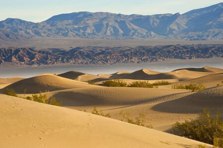 gobi: Deserts Sand dune with wind blowing sand Stock Photo