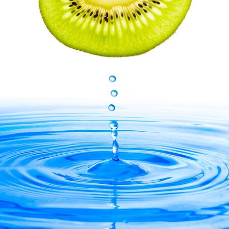 Kiwi with water drop water on blue water with white backdrop photo