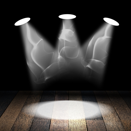 Spotlight with smoke on wooden floor photo