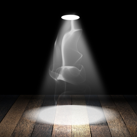 Spotlight with smoke on wood floor photo