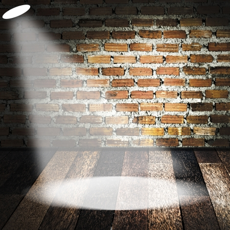game show: Spotlight on wooden floor and brick wall Stock Photo