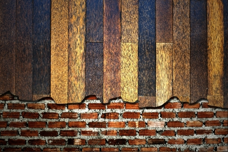 Brick wall with wooden on top photo