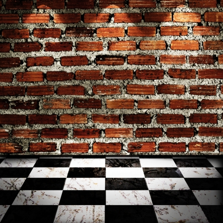 Black And White Checker floor with brick wall and spot light photo