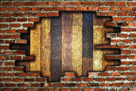 Brick wall broken to show wooden wall photo