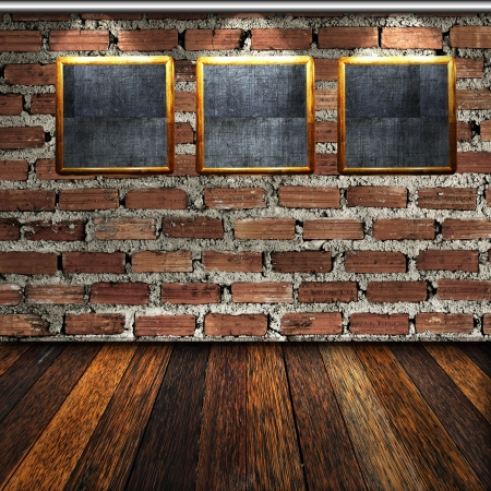 Blank photo frame in room with wooden floor and brick wall