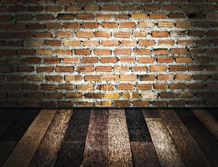 Wooden floor and brick wall photo