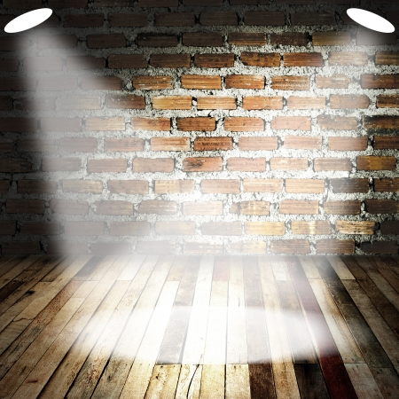 Spot light with smoke on wood floor and brick wall photo