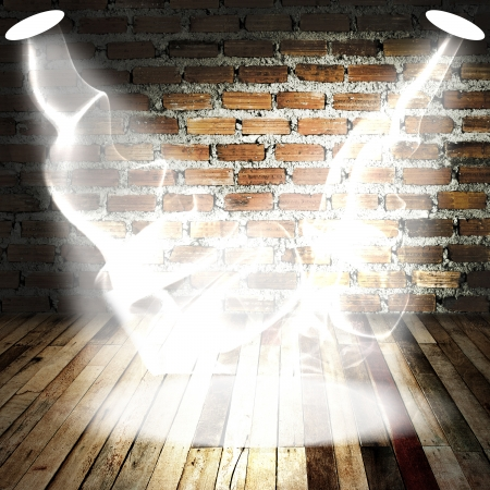 destroyed: Spot light with smoke on wood floor and brick wall Stock Photo