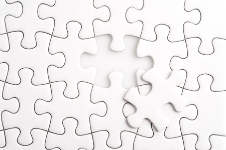 Missing Jigsaw puzzle in red color jigsaw  Business concept for completing team with key person Stock Photo - 13366150