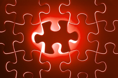 Missing Jigsaw puzzle in red color jigsaw  Business concept for completing team with key person photo