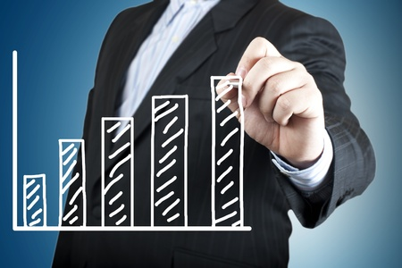 Business man hand drawing a chart Stock Photo - 13484597