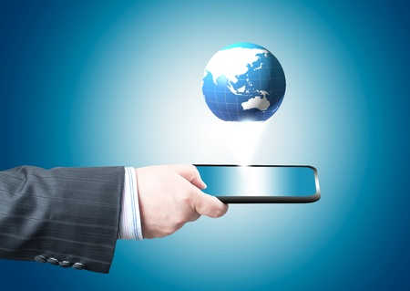 Businessman holding tablet PC screen with blue internet globe and email coming out from the screen  Concept for internet and connectivity Stock Photo - 13484608