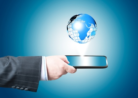 article marketing: Businessman holding tablet PC screen with blue internet globe and email coming out from the screen  Concept for internet and connectivity