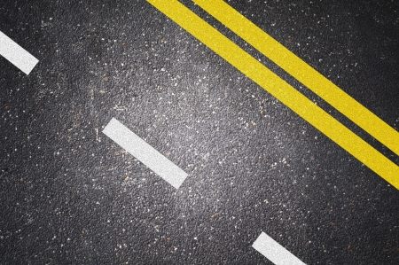 Asphalt road texture with yellow and white stripe photo