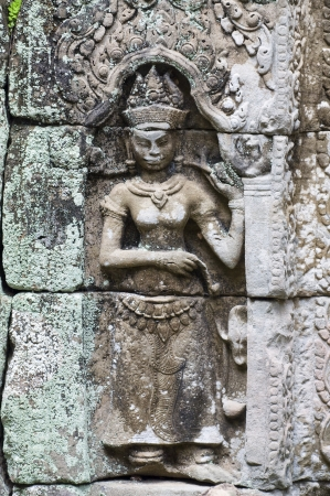 carving on the stone in Cambodia photo