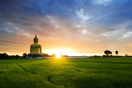 Buddha Statue in Thailand on rural landscape  photo