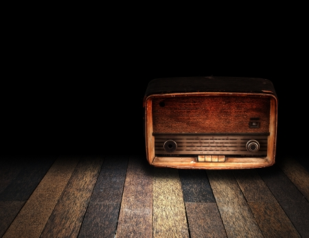 vintage radio: Old room with wooden floor and vintage radio with fade to black background Stock Photo