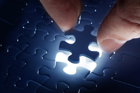 search solution: Missing jigsaw puzzle piece with light glow, business concept for completing the final puzzle piece