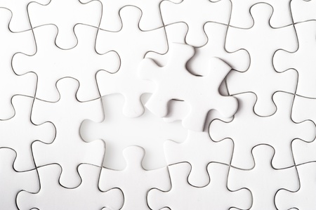 Missing jigsaw puzzle piece with light glow, business concept for completing the final puzzle piece Stock Photo - 13546257