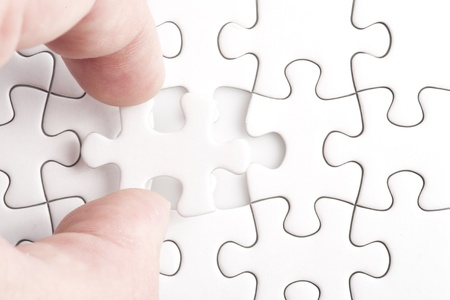 final piece of the puzzle: Missing jigsaw puzzle piece with light glow, business concept for completing the final puzzle piece