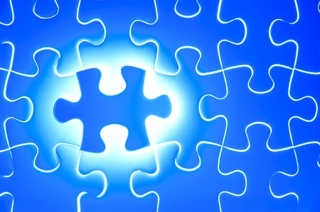 Missing jigsaw puzzle piece with light glow, business concept for completing the final puzzle piece Stock Photo - 13546269