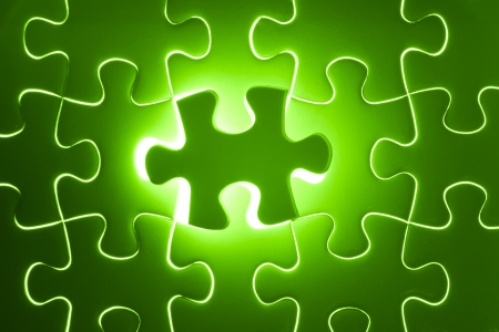 Completing the missing Jigsaw puzzle concept for business with completing the team with final person Stock Photo - 14257133