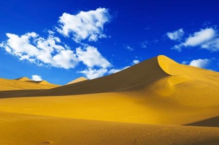 hummock: Sand dune on blue sky
