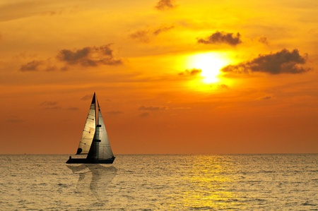 Sailboat at with sunset photo