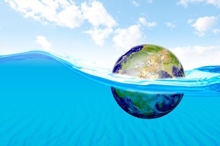 Beautiful ocean with view of sand underwater and floating earth   photo