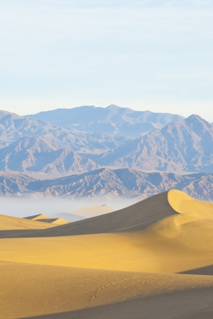 Sandy desert with mountain and clear sky
