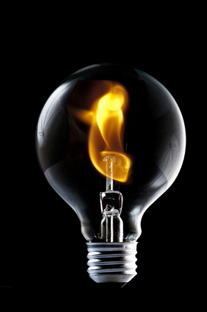 magical equipment: Fire and smoke in side the light bulb  Concept for energy consumption and environmental awareness  Stock Photo